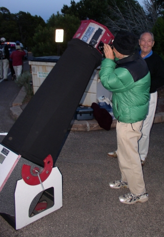 John Dobson, using a Dobsonian alt-az reflector