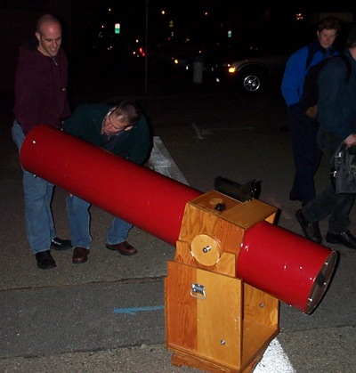 A Dobsonian telescope showing a lunar eclipse to the public