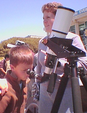 Refractor telescope, on an alt-azimuth tripod mount