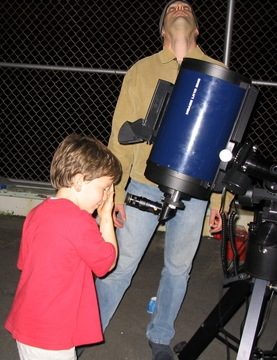 Youngster viewing through a Schmidt-Cassegrain telescope